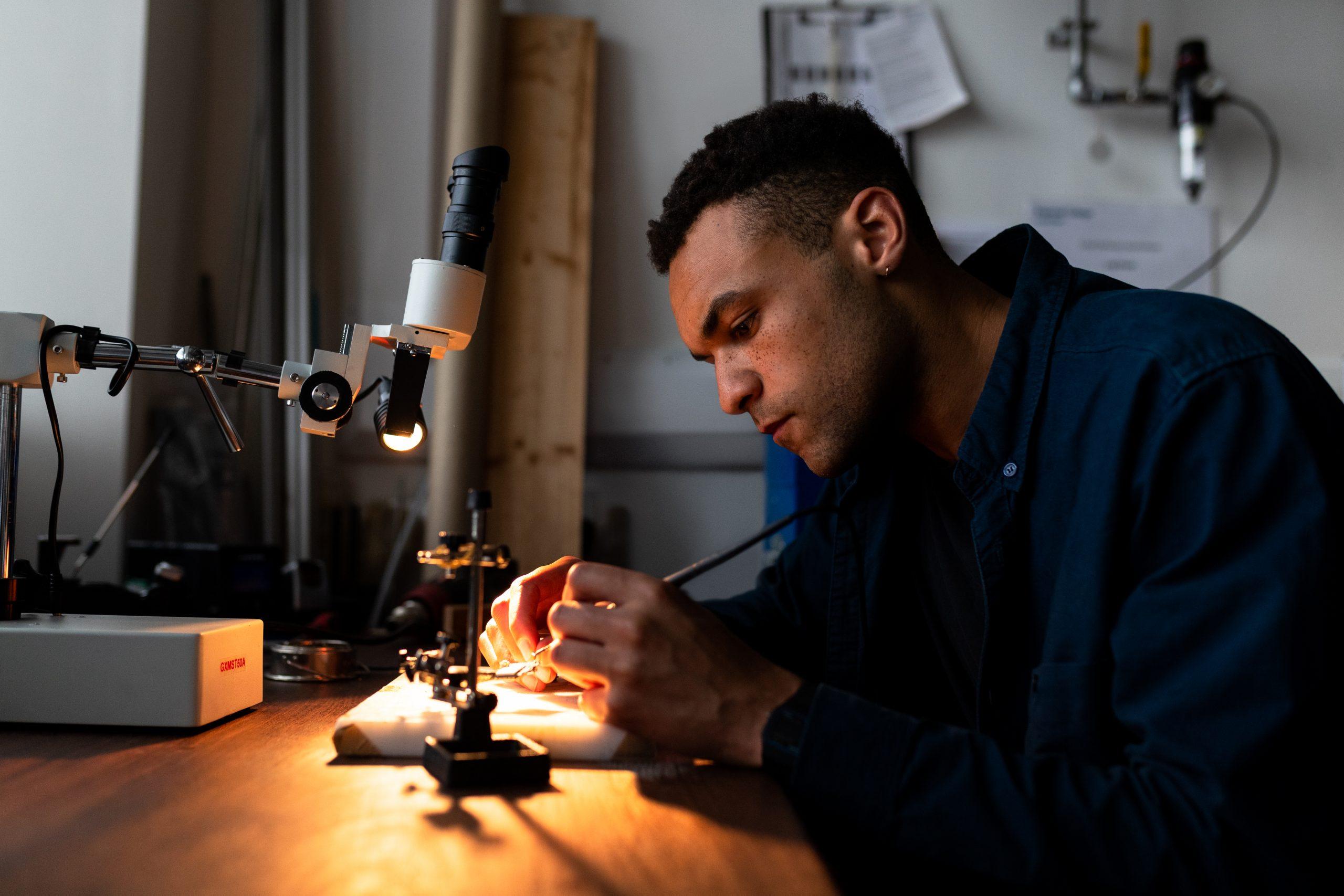 Mechanical engineer soldering in workshop
